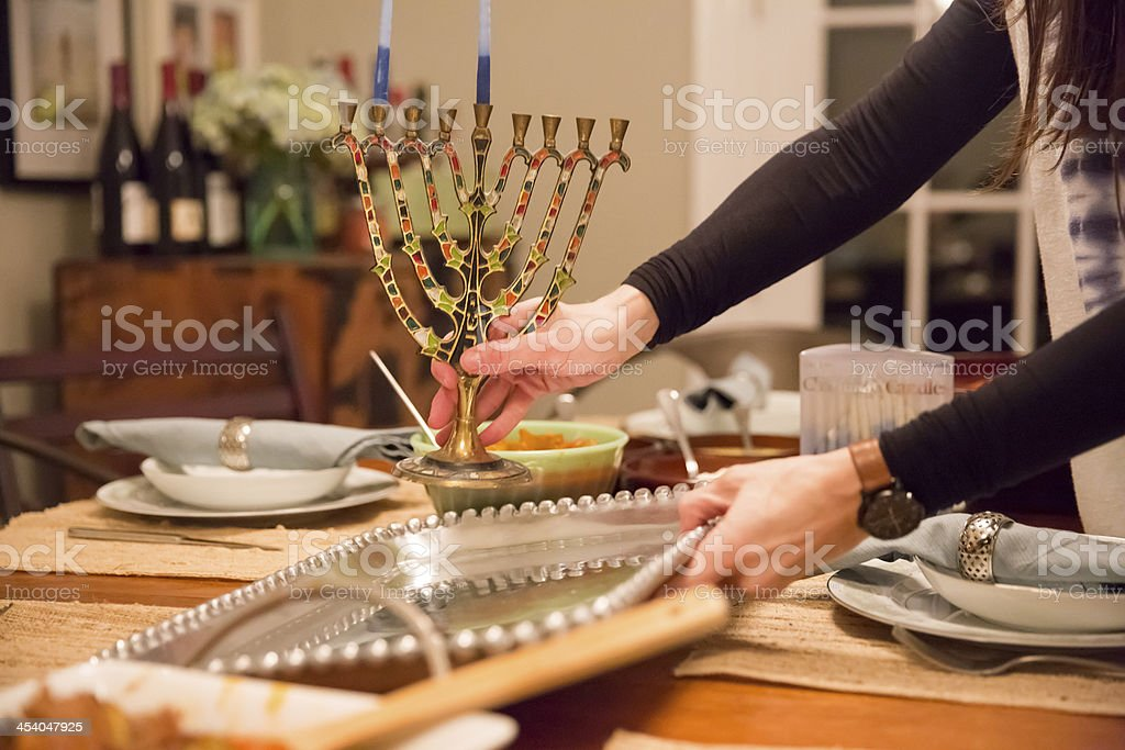 Table being set for a dinner celebrating Hanukkah stock photo