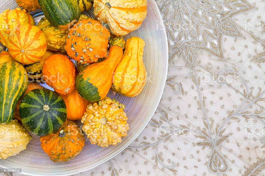 Table centerpiece with ornamental pumpkins stock photo