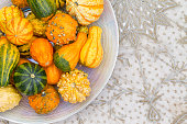 Table centerpiece with ornamental pumpkins