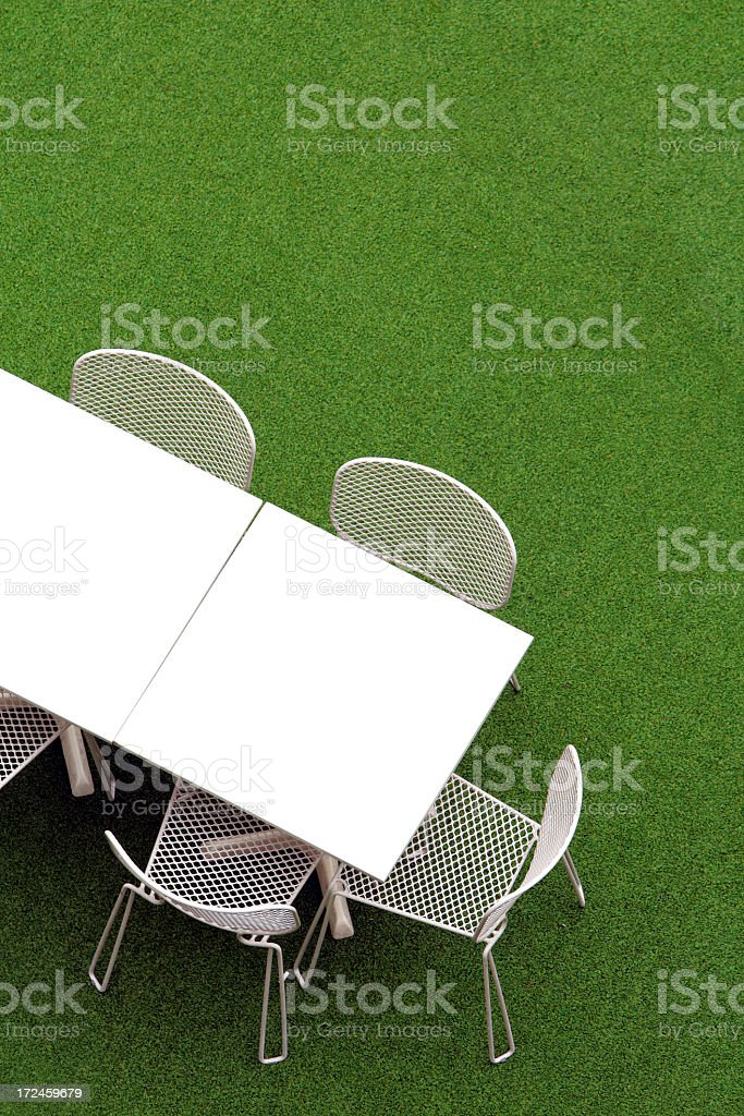Table, chair on the grassland royalty-free stock photo