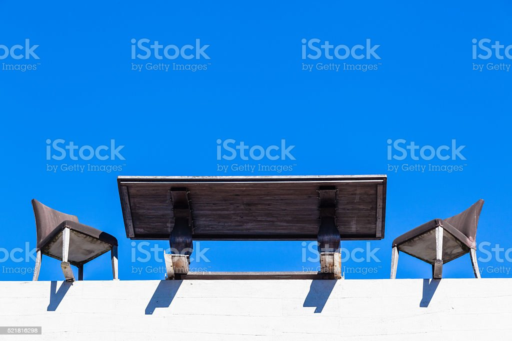 Table Chairs Building Edge Blue stock photo