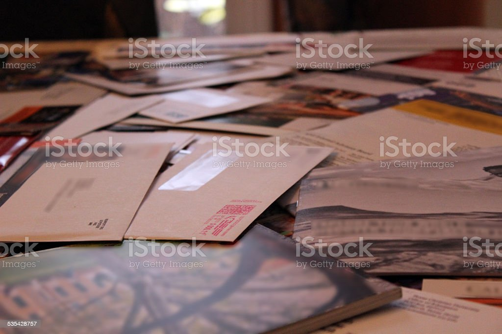 Table Covered with Junk Mail Envelopes stock photo