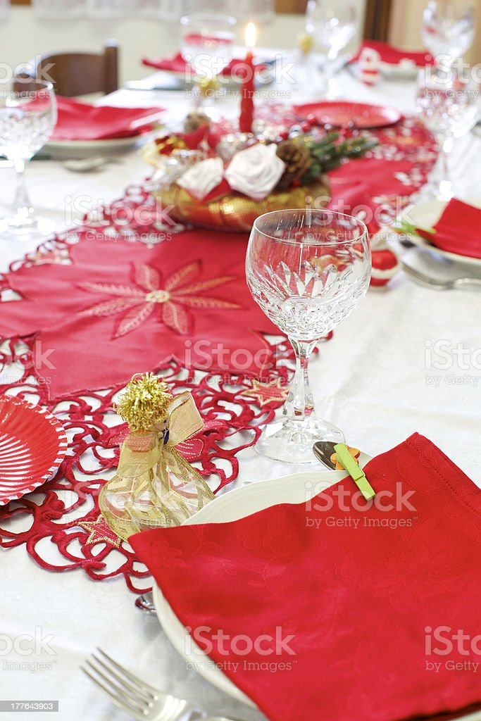 A table decorated with red and gold Christmas decorations. royalty-free stock photo