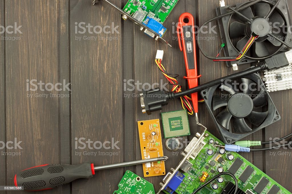 Table electronics repairman. Home computer repair stock photo