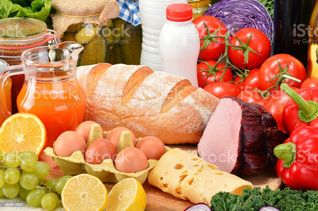 A table filled with a variety of grocery products stock photo