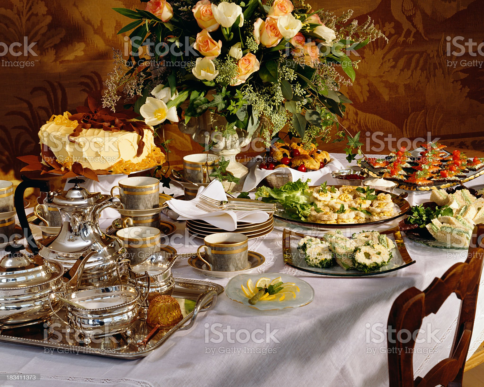 Table filled with tea and sandwiches for a party royalty-free stock photo