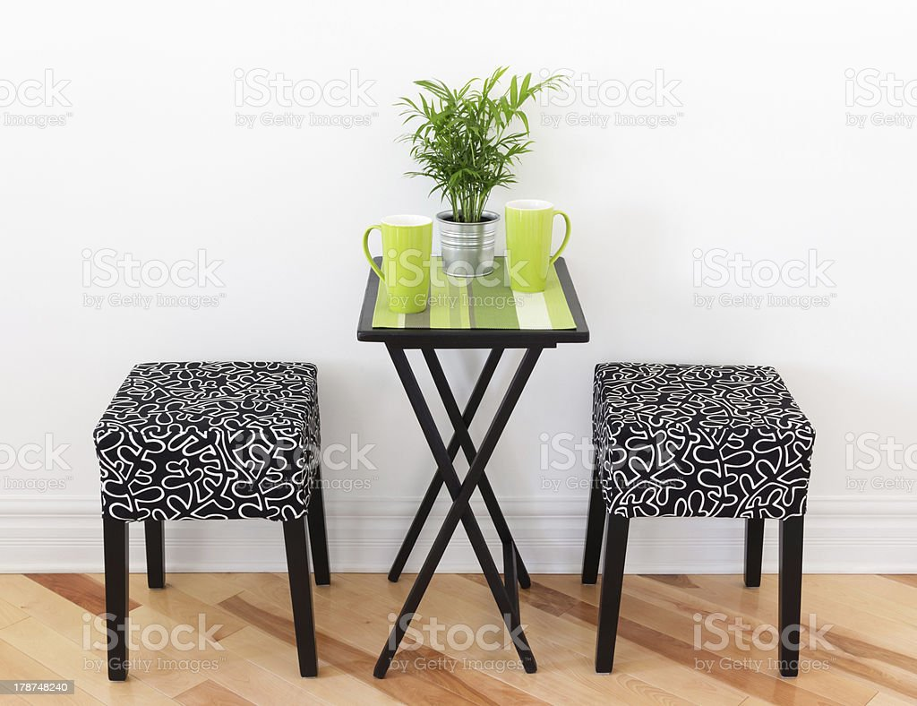 Table for two with green cups royalty-free stock photo
