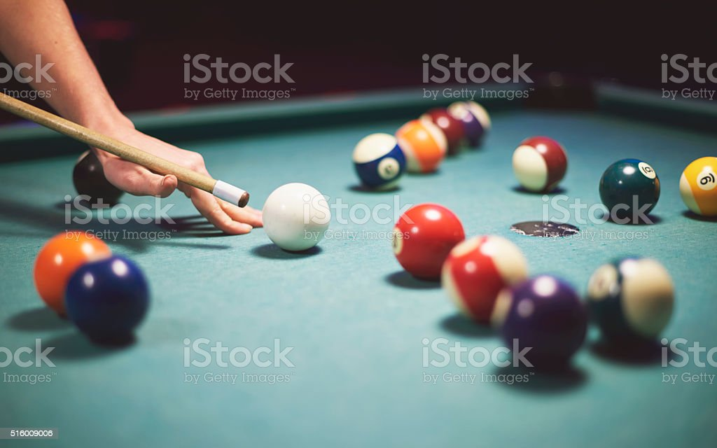 Table full of colorful cue balls stock photo