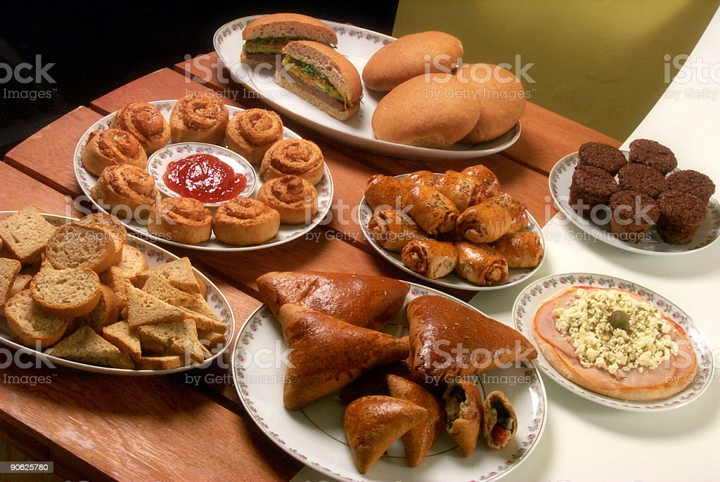 Table full of food (bread) stock photo