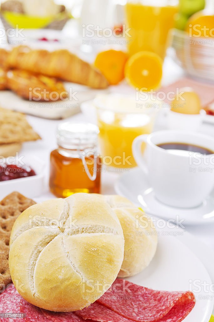 Table full with continental breakfast items, brightly lit royalty-free stock photo