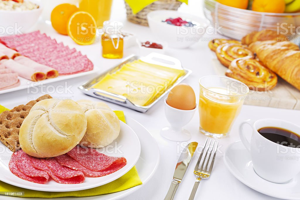 Table full with continental breakfast items, brightly lit stock photo