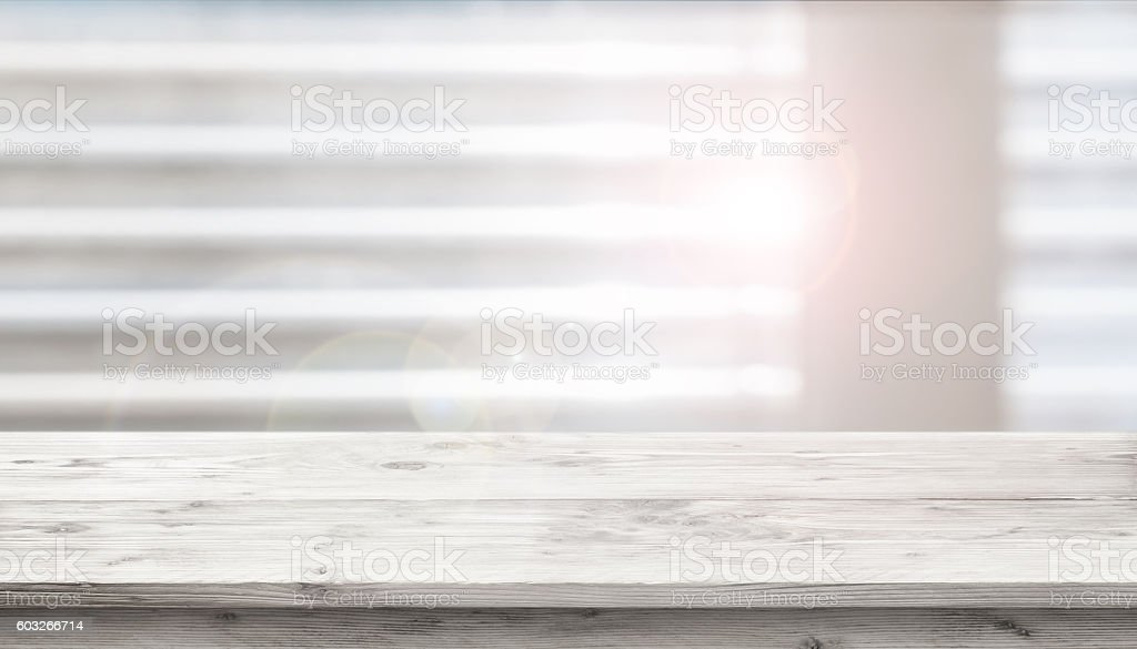 Table in front of a window stock photo