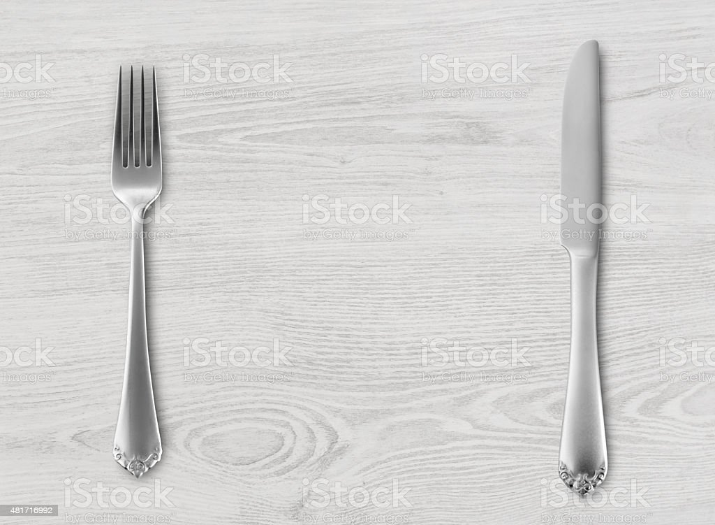 Table knife and fork on wood stock photo