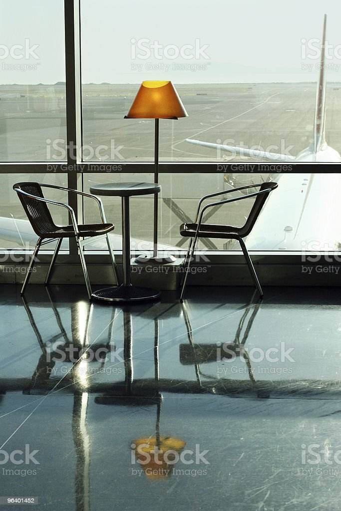 Table, lamp and two chairs at the airport royalty-free stock photo