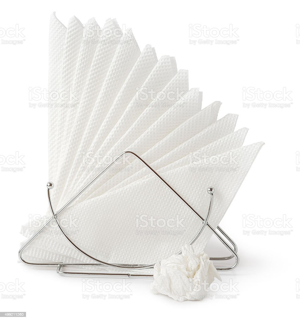 Table napkin holder with crumpled napkin stock photo