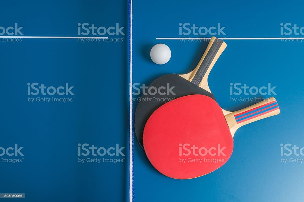 Table, net and rackets for playing ping pong stock photo