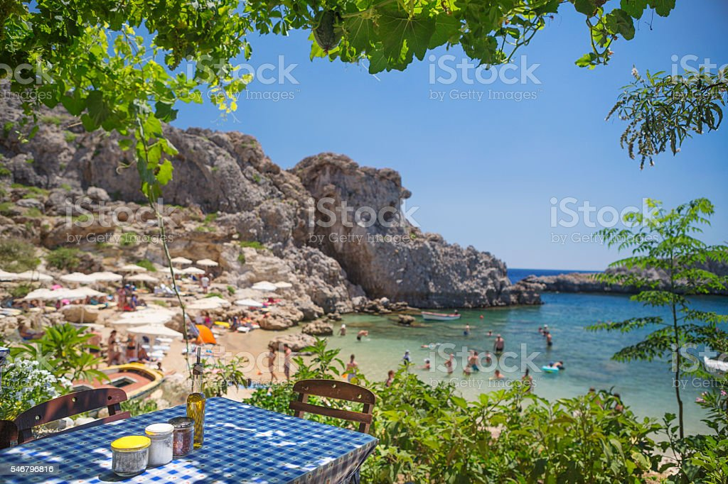 Table of a Traditional Greek Tavern with a Beach Background stock photo