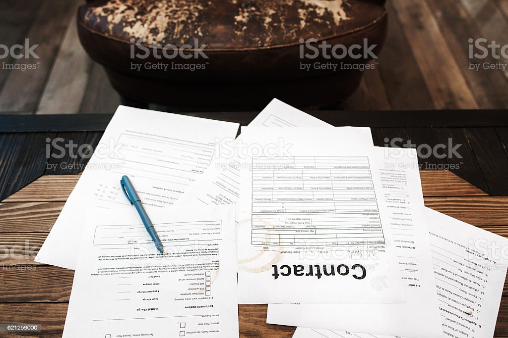 Table of busy businessman with papers, top view stock photo