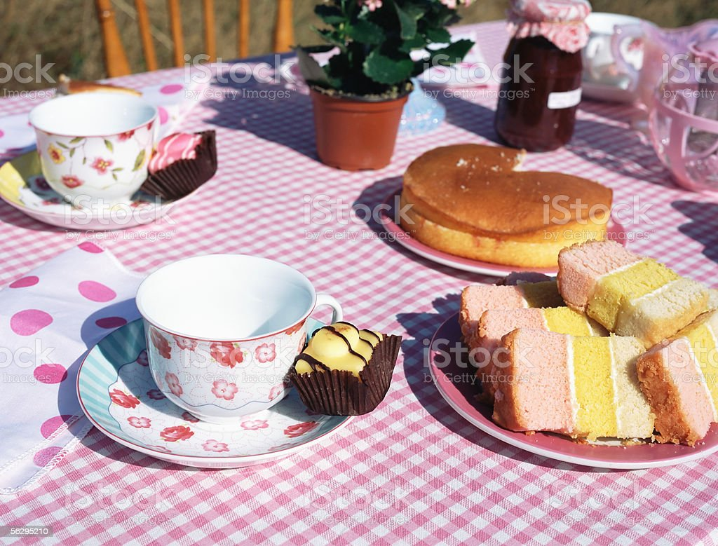 Table of tea and cakes stock photo