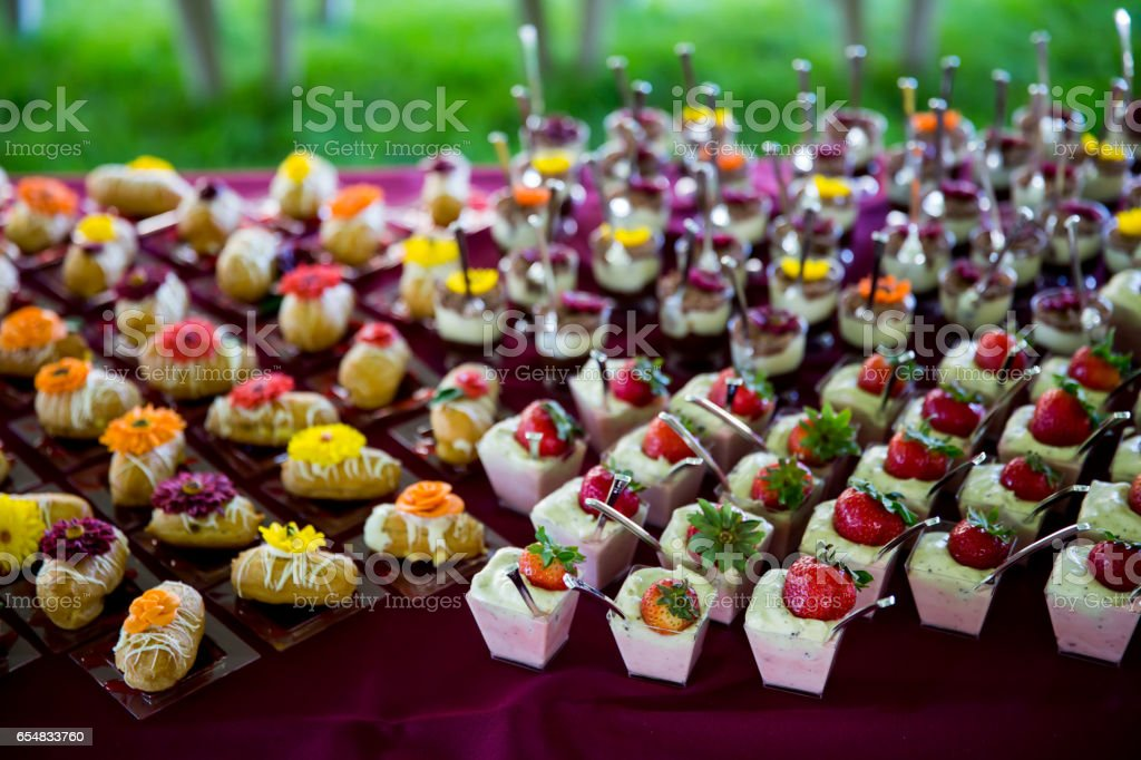 A Table of Various Colorful Desserts stock photo