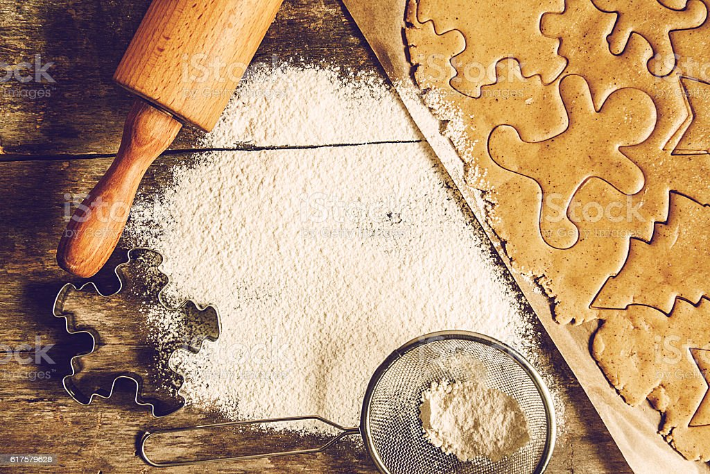 table rolled out dough, flour, Christmas shapes, style shabby in stock photo