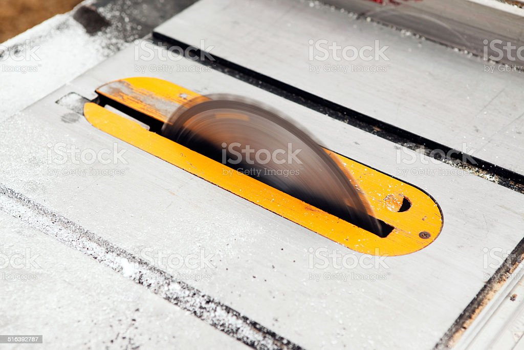 Table Saw Blade Spinning without Guard stock photo