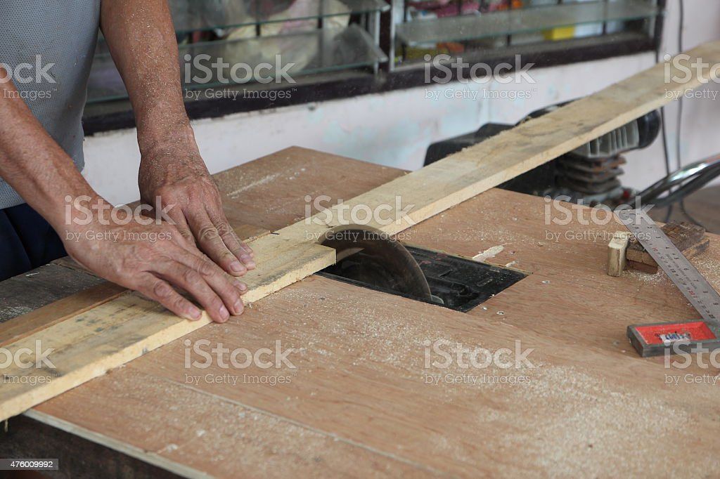 table saw for cutting wood at workshop stock photo