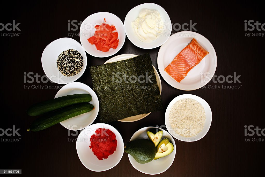 Table served with Ingredients of sushi and traditional japanese food stock photo