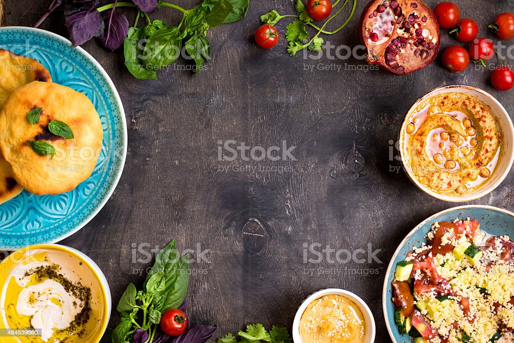 Table served with middle eastern vegetarian dishes. Hummus, tahi stock photo