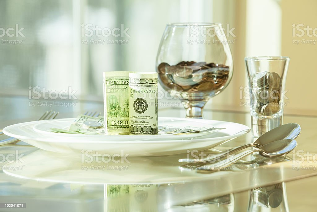 Table served with money's dishes royalty-free stock photo