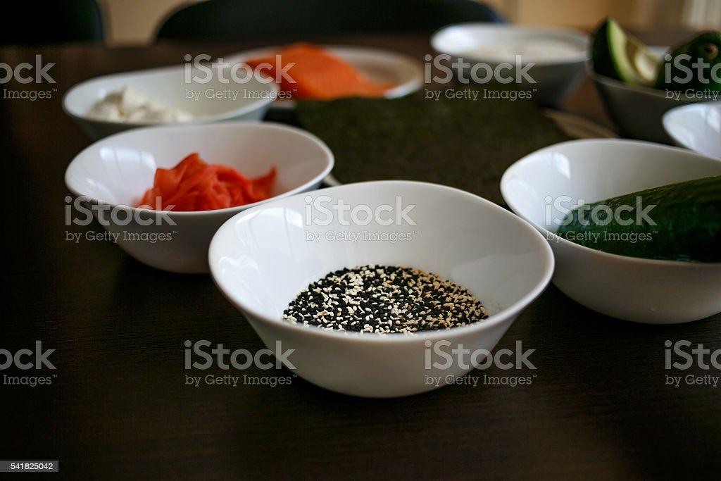 Table served with sushi and traditional japanese food on dark stock photo
