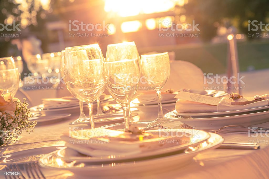 Table set dinner at sunset stock photo