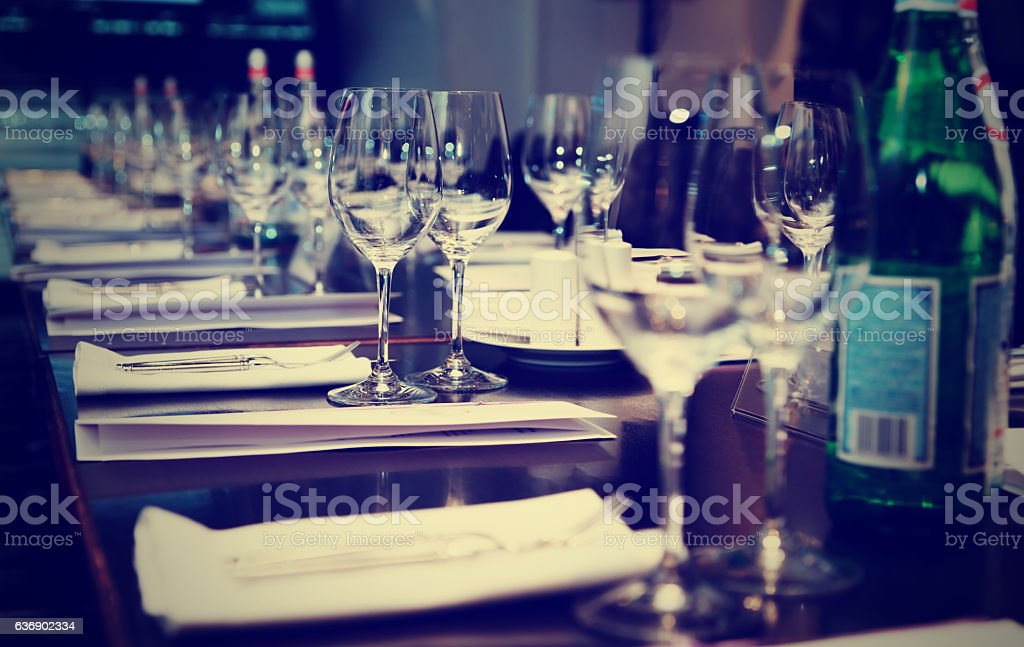Table set for official dinner, toned stock photo