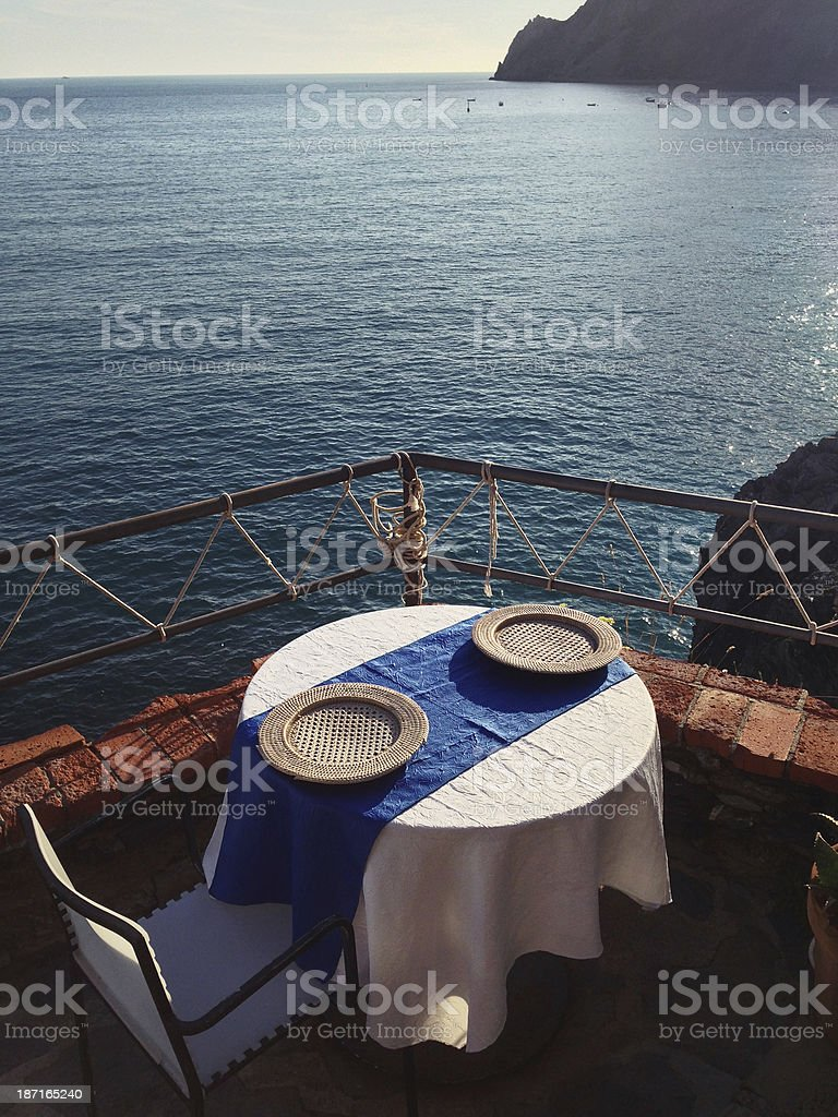 Table set for two with sea view stock photo