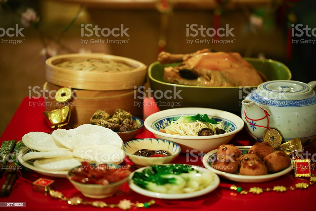 Table set out with food for Chinese New Year feast stock photo