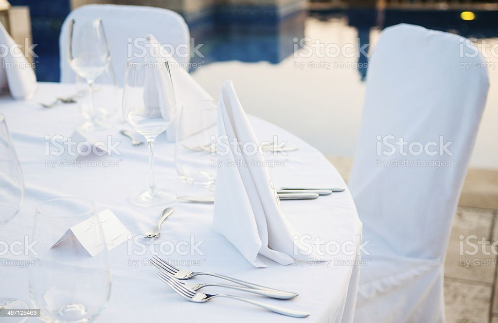 Table setting at beach restaurant stock photo