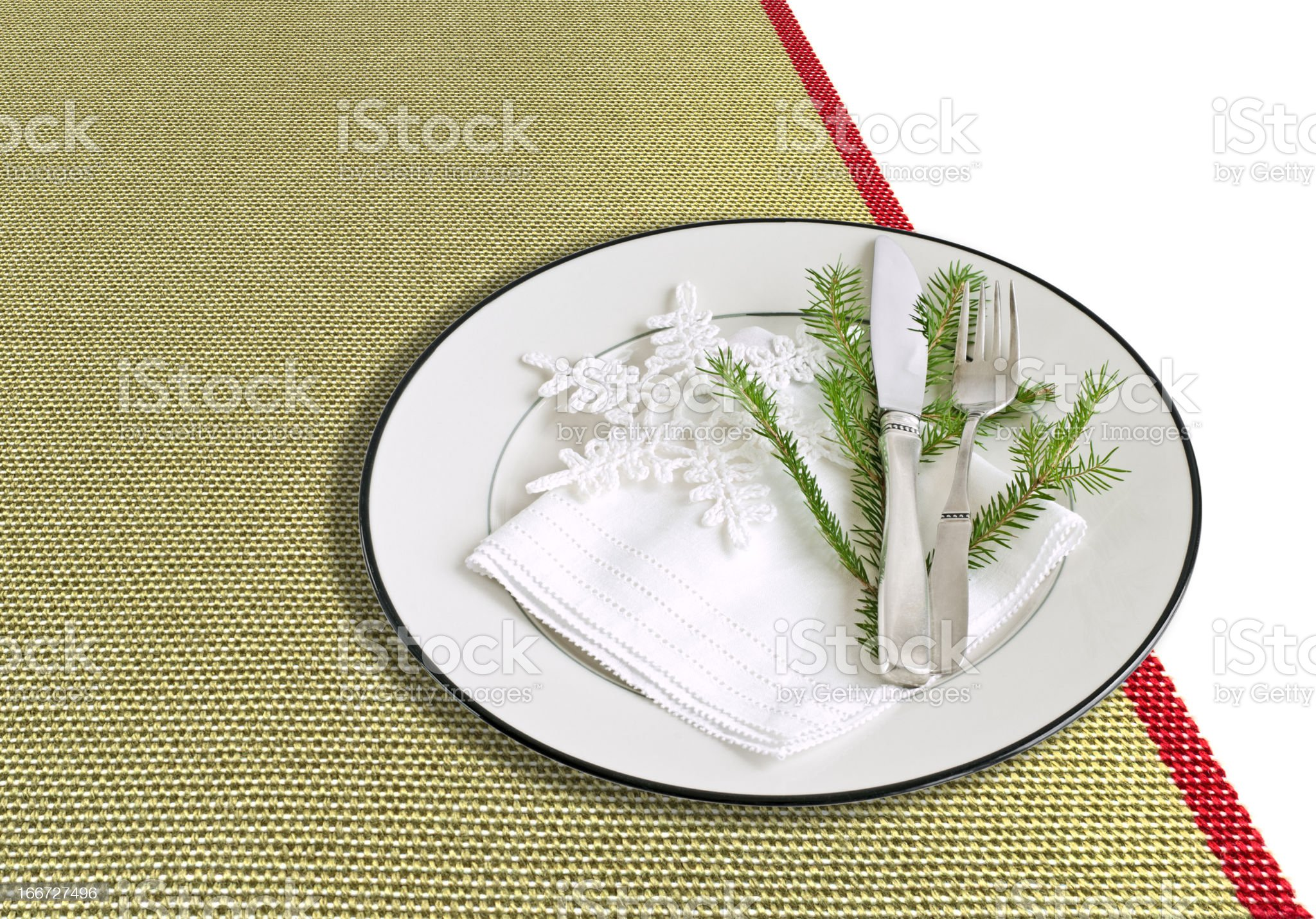Table setting for Christmas on a green tablecloth royalty-free stock photo