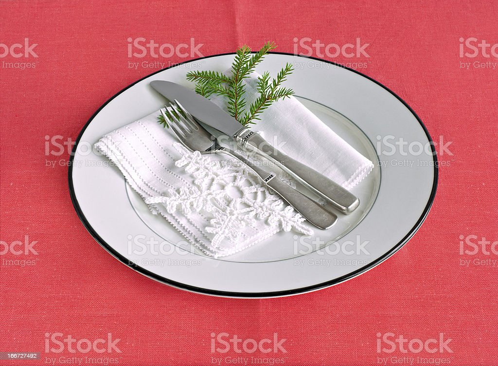 Table setting for Christmas on a red tablecloth royalty-free stock photo