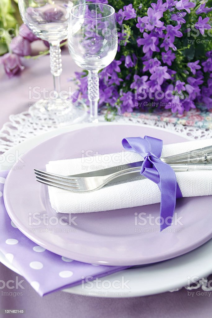 Table setting in purple color royalty-free stock photo