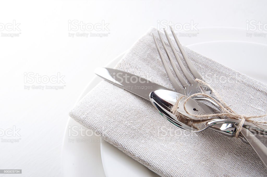 Table setting in white and gray colors stock photo