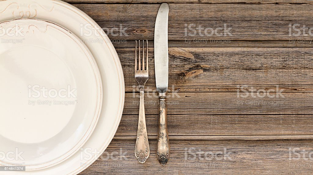 Table setting of plates and cutlery stock photo