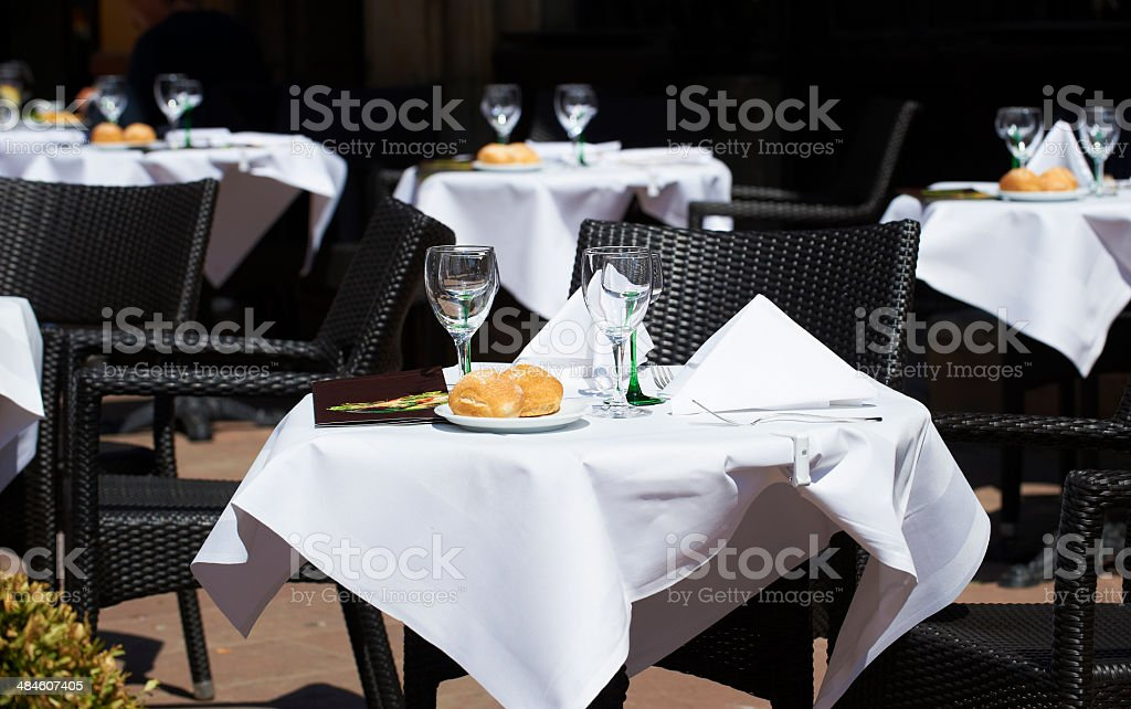 table setting outside at restaurant in summer stock photo