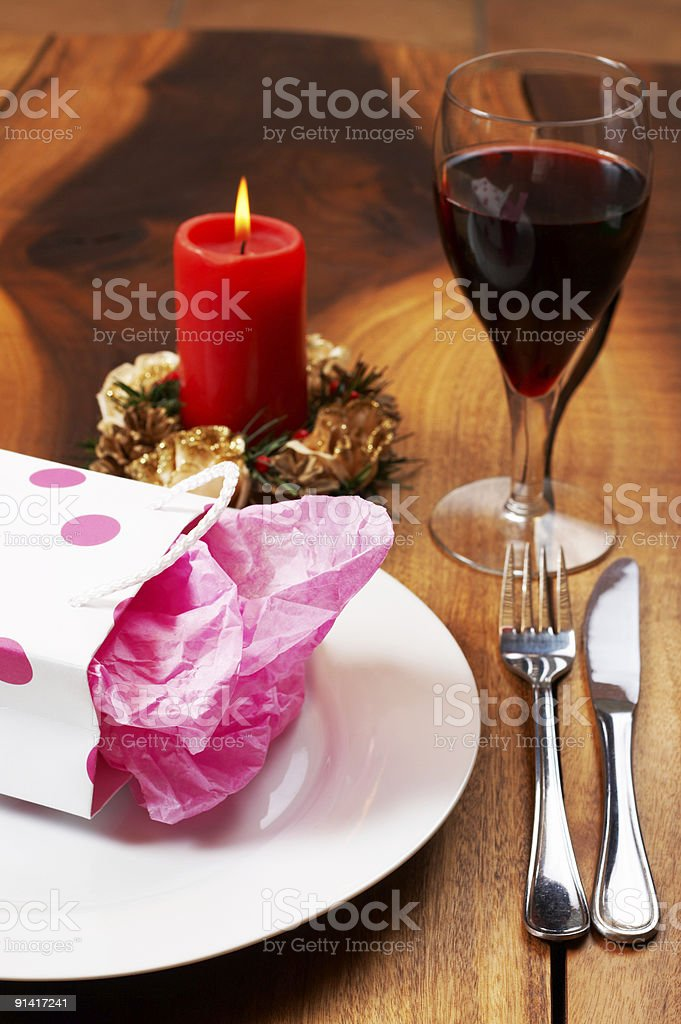 Table setting with a gift bag on plate royalty-free stock photo