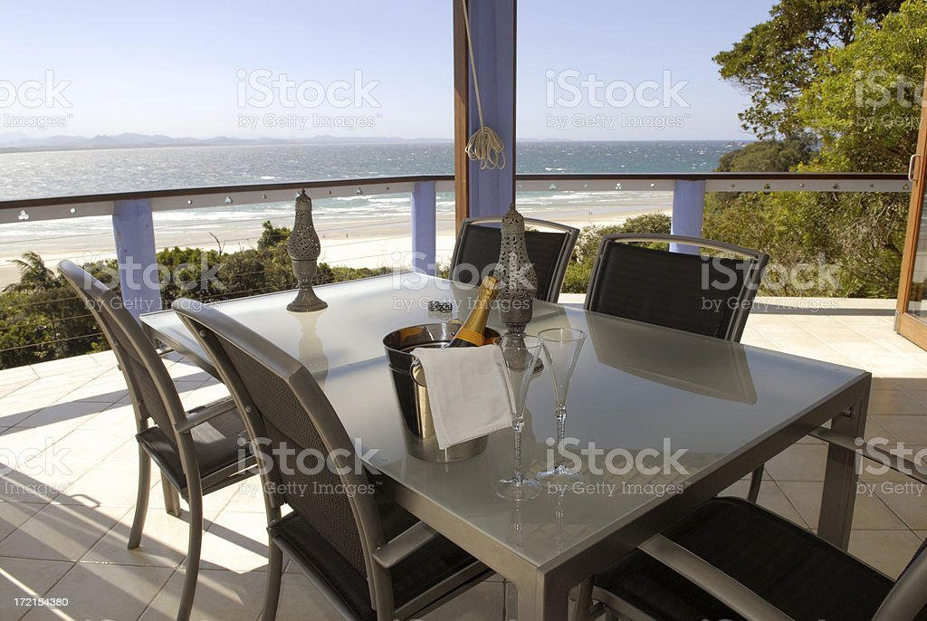 Table setting with a view to the beach royalty-free stock photo