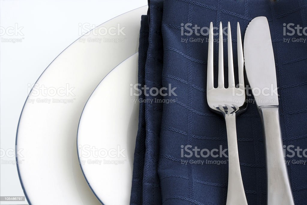 Table Setting with Blue Napkin royalty-free stock photo