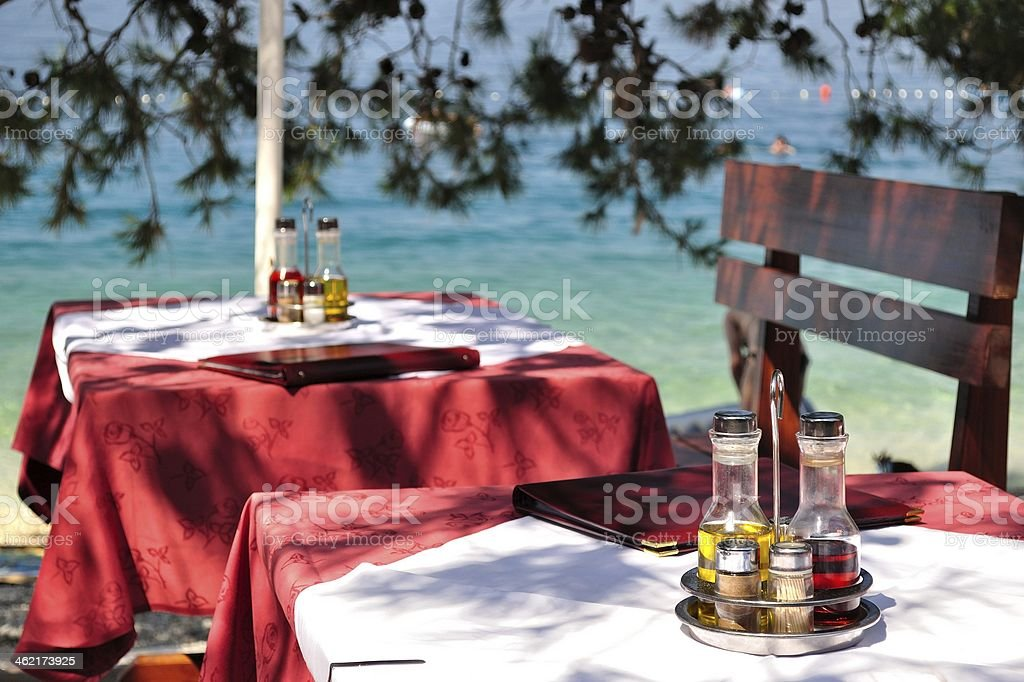 Table setting with bottles in restaurant royalty-free stock photo