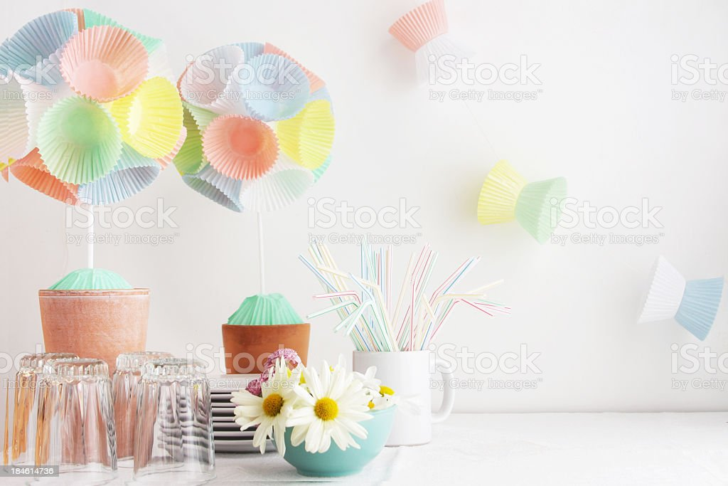 Table setting with garlands, daisy flowers and paper pom pons stock photo