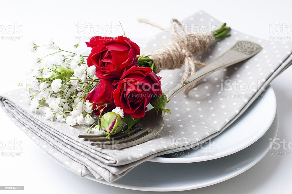 table setting with red roses, napkins and vintage crockery royalty-free stock photo