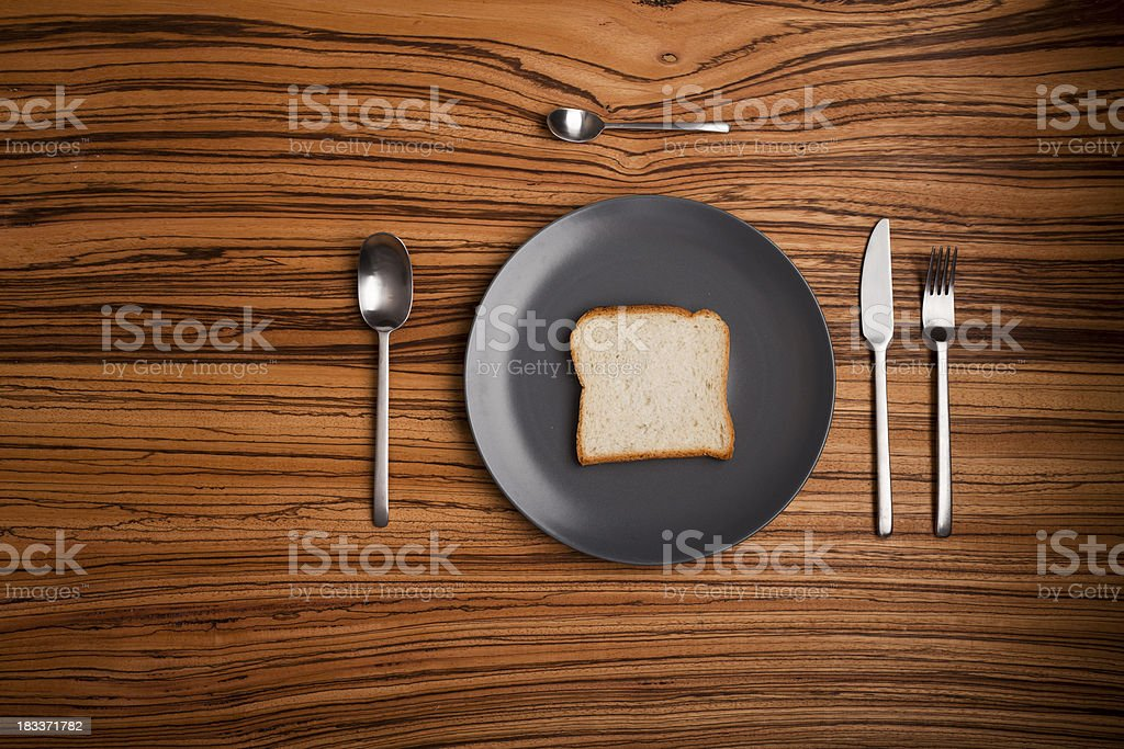 table setup with a bread slice instead of food stock photo
