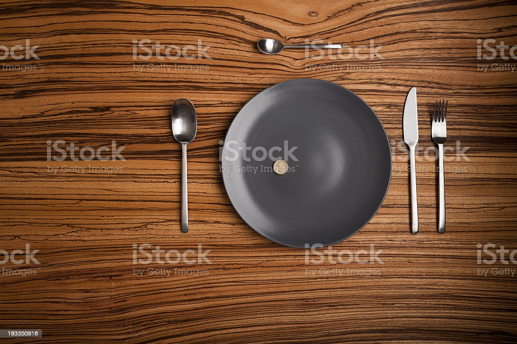 table setup with a coin instead of food stock photo